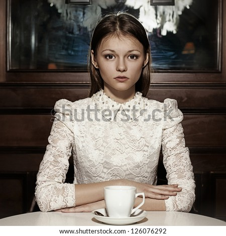 Portrait beautiful woman drinking coffee in a cafe - stock photo