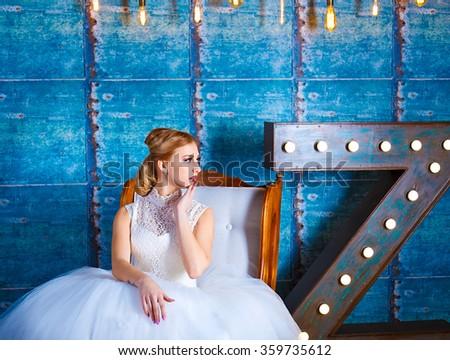 portrait beautiful woman, wearing luxurious wedding dresses in studio - stock photo