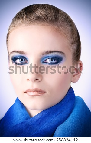 Portrait beautiful woman with blue color scarf. - stock photo