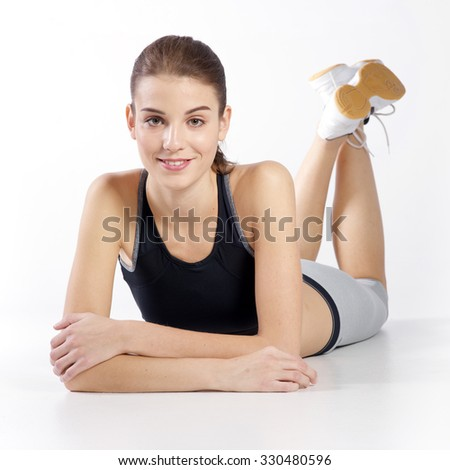 Portrait beautiful young athletic girl on a white background - stock photo