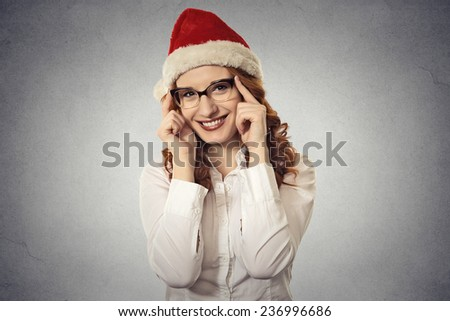 Portrait beautiful young christmas girl wearing santa claus clothes isolated on grey wall background. Positive face expression, emotion, feelings. Holiday season sale concept  - stock photo