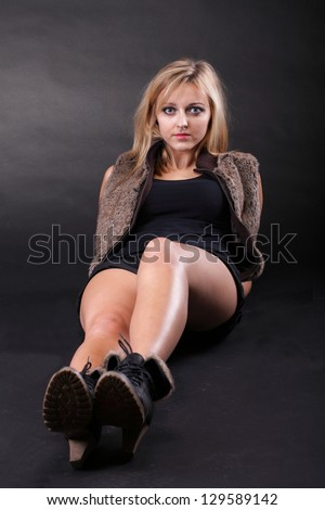 portrait beautiful Young sexy woman wearing fur black background - stock photo