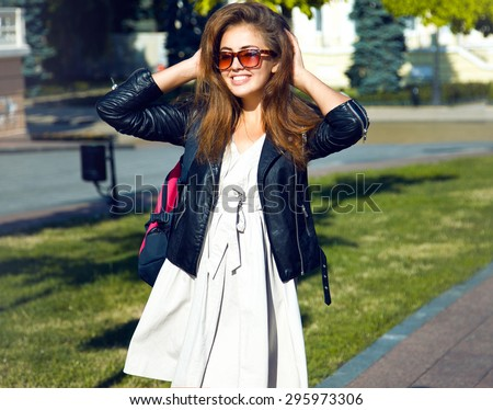 Portrait beautiful young woman hiking on summer day.Caucasian female wearing sunglasses looking away, outdoors on summer vacation.Rear view shot of young woman hiking on summer day.view with sun flare - stock photo