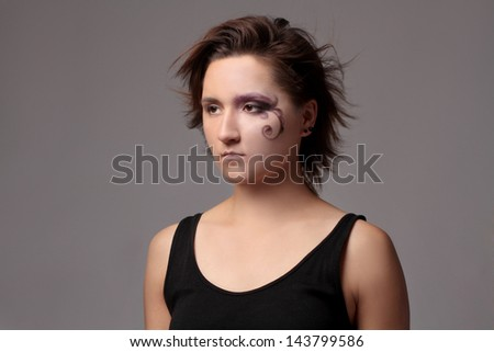 Portrait beauty shoot of young trendy woman with creative bright make up - stock photo