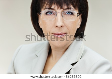 Portrait business woman aged glasses white background - stock photo