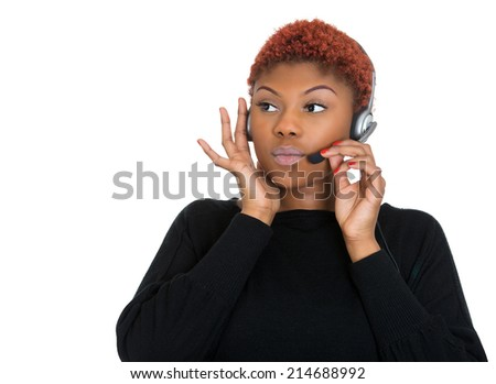 Portrait business woman, serious customer service representative call centre worker operator support staff speaking with head set listening client problem isolated white background. face expression - stock photo