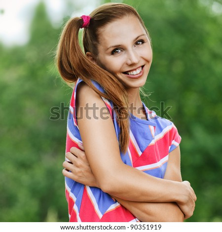 portrait cheerful beautiful young woman standing striped dress background summer green forest