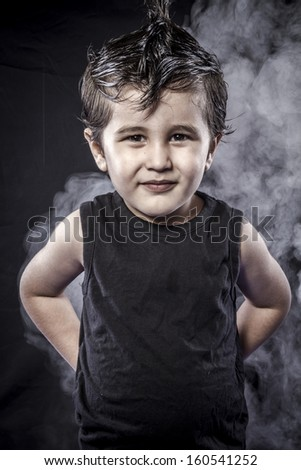 Portrait child rocker dress and funny expressions crested - stock photo