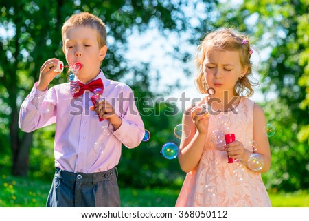 Portrait child with soap bubbles on a summer day - stock photo