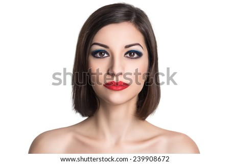 Portrait close-up of very beautiful perfect woman with bright make up, red velvet lipstick, necked shoulders pretty face, stylish hair do, smoky eyes Clean white wall photo studio background isolated. - stock photo