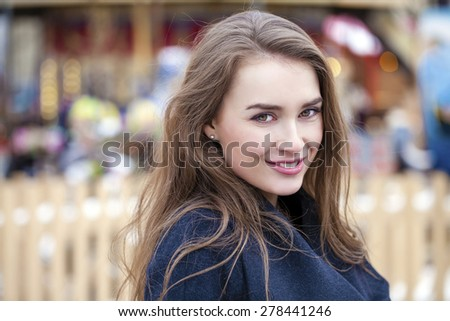 Portrait close up of young beautiful blonde woman, on spring street background  - stock photo