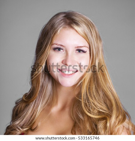 Portrait close up of young beautiful happy blonde woman, indoor