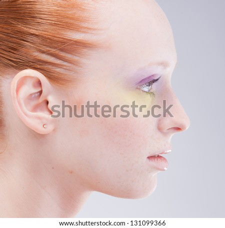 Portrait close up profile of young woman - stock photo
