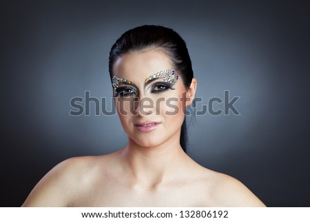 Portrait close-up shot of glamorous woman with jewelry make-up