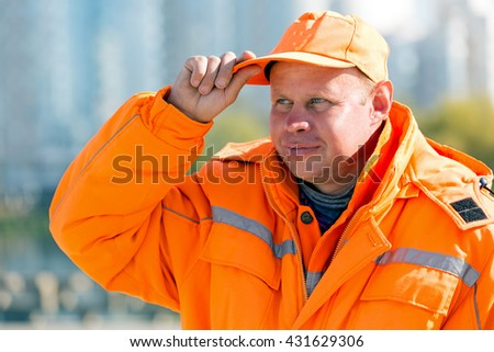 Portrait construction road man worker or city janitor on town background - stock photo