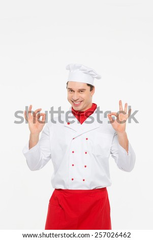 portrait cook man doing a success symbol against isolated on white - stock photo