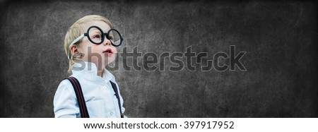 Portrait Cute Little Boy with Glasses Child Prodigy Dark Chalking Board Empty Concept Back to School Black Background  - stock photo