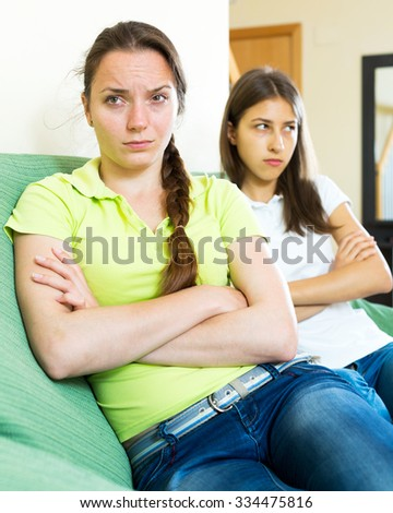 portrait depressed adult women looking away after conflict at home