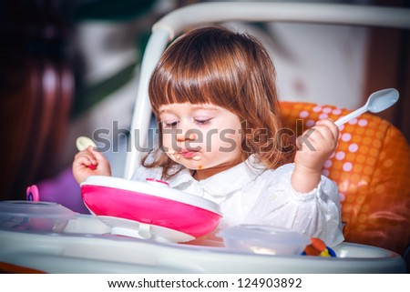 Portrait eating baby girl