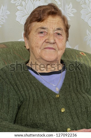 Portrait elderly woman - stock photo