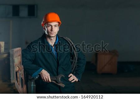 portrait electrician worker in helmet - stock photo