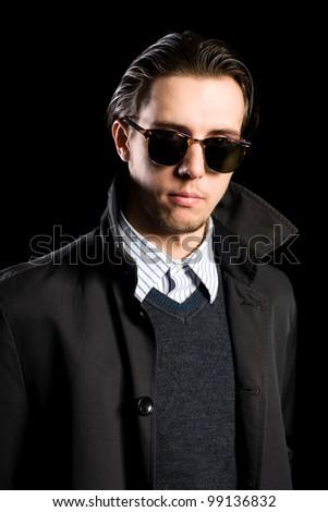 Portrait elegant young man in sunglasses - stock photo