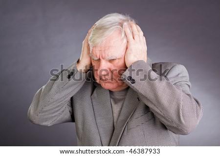 Portrait emotional elderly men on a grey background - stock photo