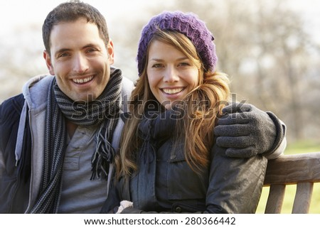 Portrait family outdoors in winter - stock photo