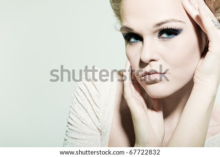 Portrait fashion woman with bright eyes - stock photo