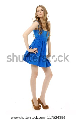 portrait fashion young woman in blue dress on white background