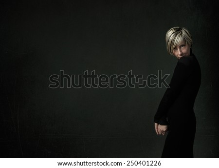 portrait for a timid blonde woman - stock photo