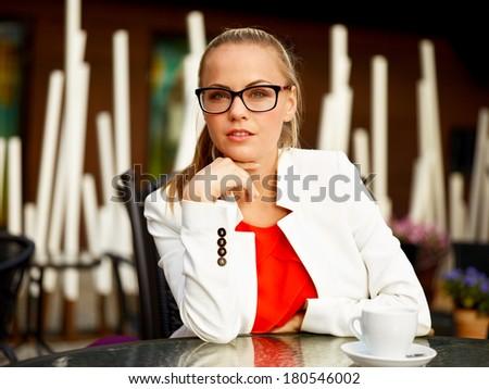 Portrait for fashionable young woman enjoying her coffee break - stock photo