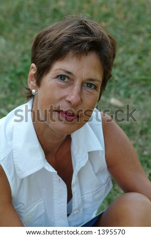 Portrait from a middle aged woman - stock photo