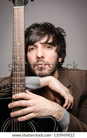 portrait from a young singer with his guitar - stock photo
