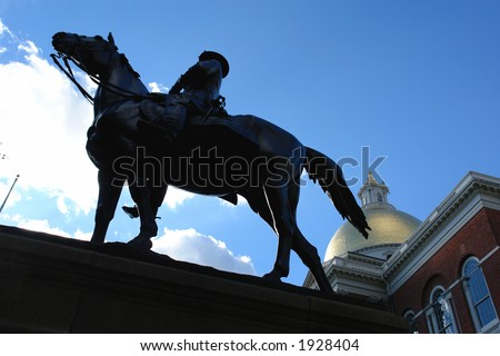 Portrait from the left of the horse against a deep blue sky with the state house in the background.Nickname:Fighting Joe PlaceÊofÊbirth: Hadley, Massachusetts Allegiance: United States