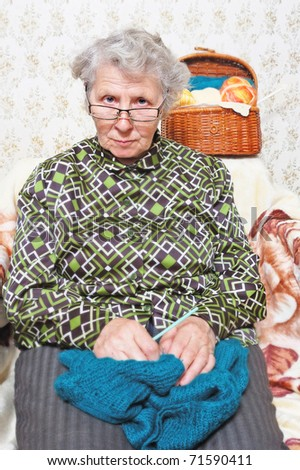 portrait funny elderly woman in two glasses - stock photo