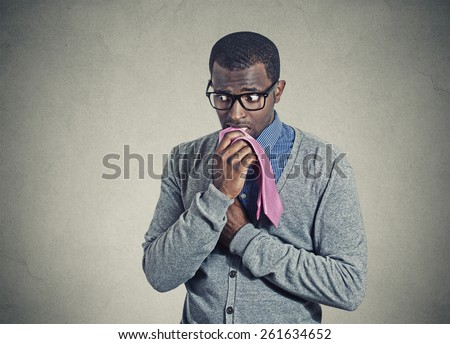 Portrait geeky nervous anxious businessman bitting chewing his tie  - stock photo