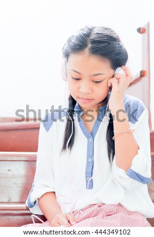 portrait girl listen music,Young Asia girl with headphones, teenage girl listening to music .
