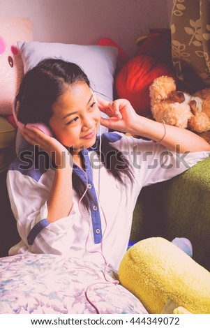 portrait girl listen music,Young Asia girl with headphones, teenage girl listening to music .autumn style  - stock photo