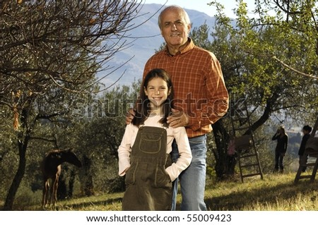 portrait grandfather and granddaughter - stock photo