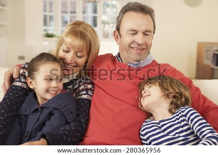 Portrait grandparents and grandchildren at home - stock photo