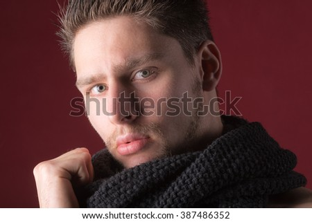 Portrait handsome attractive male model - Close up sexy attractive young man against a dark red background - stock photo