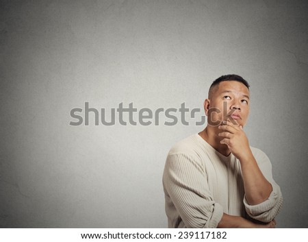 Portrait handsome middle aged man thinking looking up isolated grey wall background with copy space. Human face expressions, emotions, feelings, body language, perception - stock photo