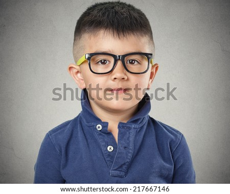 Portrait happy child with glasses on grey wall background. Face expressions - stock photo