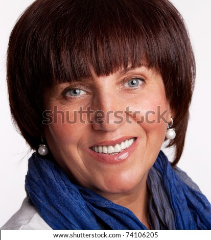 Portrait happy mature woman looking at camera - stock photo