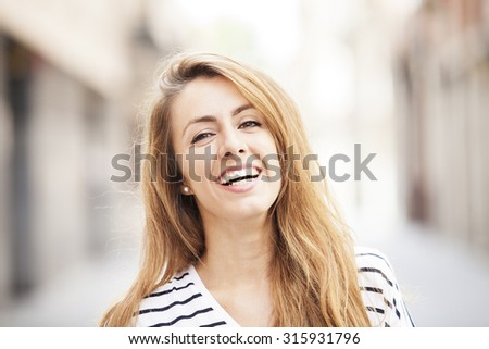 Portrait happy smiling woman outdoors - stock photo