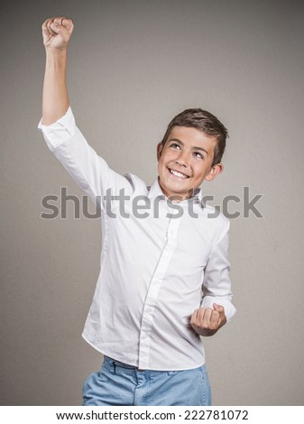 Portrait happy successful student, young man winning, fists pumped celebrating success isolated grey background. Positive human emotion, facial expression body language. Life perception, achievement - stock photo