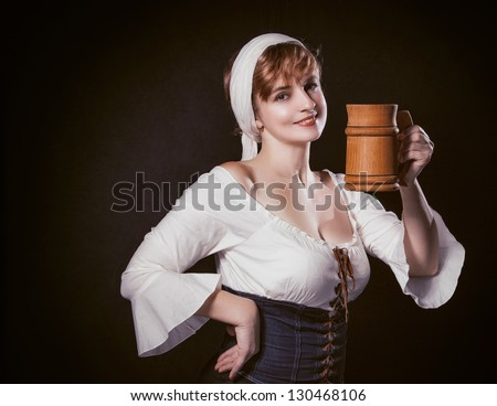 Portrait Happy woman with a wooden mug - stock photo