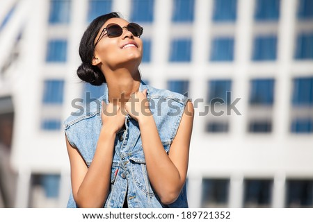 Portrait happy young brunette woman posing outdoor - stock photo