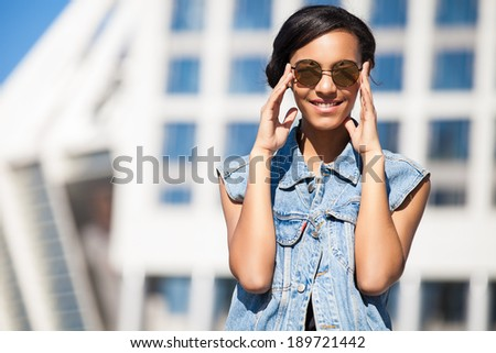 Portrait happy young brunette woman posing outdoor